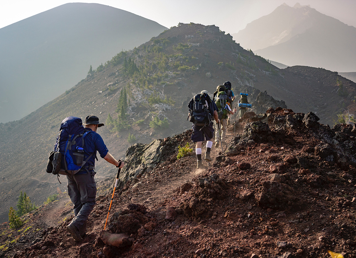 group-of-person-walking-in-mountain-1365425